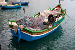 Traditional Maltese Boat. In a popular and quaint harbor village in Malta Royalty Free Stock Images