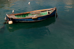 Traditional Maltese Boat. In a popular and quaint harbor village in Malta Stock Photo