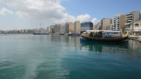 The traditional Maltese boat for tourists cruises. SLIEMA, MALTA - APRIL 22: The traditional Maltese boat for tourists cruises on April 22, 2015 in Sliema, Malta stock footage