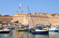 Traditional maltese boats and yachts moored in the Kalkara Creek. BIRGU, MALTA - AUGUST 1, 2015:  Traditional maltese boats and yachts moored in the Kalkara Stock Image