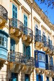 Traditional Maltese buildings, Valletta. Traditional buildings with wooden and iron balconies, Valletta, Malta, Europe Royalty Free Stock Images