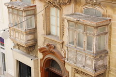 Traditional Maltese closed wooden balconies Malta.  Royalty Free Stock Images