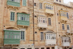 Traditional Maltese closed wooden balconies Malta.  Stock Photos