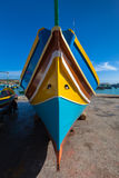 Traditional Maltese colorful boat. Traditional colors and eyes found on the traditional Malta fishing boats, commonly known as luzzu or dghajsa. The eyes are Royalty Free Stock Photo