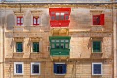 Traditional colorful wooden balconies, Malta. The traditional Maltese colorful wooden balconies in Sliema, Malta Stock Photography