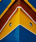 Traditional maltese colours background.Traditional colors and eyes found on typical Malta fishing boats.Maltese fishing boat fragm. Ent. Decorative. Boat decor Royalty Free Stock Photography