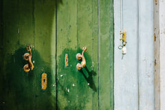 Traditional maltese door. With brass dolphin door knockers Royalty Free Stock Photo