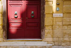 Traditional maltese door. MDINA, MALTA - MARCH 10 2017: The red wooden doors of Saint Dorothys Convent in the heart of Silent City Mdina Royalty Free Stock Photography