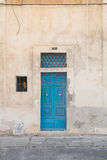Traditional Maltese door painted blue. Traditional Maltese blue wooden house door shot straight-on in Valletta, Malta, Europe. Used in the 2015 filming of the Royalty Free Stock Photo