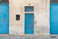 Traditional Maltese doors painted blue. Traditional Maltese blue wooden doors shot straight-on in Valletta, Malta, Europe. Used in the 2015 filming of the Stock Image