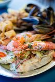 Maltese seafood and fish platter. Traditional maltese fish and seafood platter set mix of calamari rings in tempura, giant shrimps, clams, fish fillets and Stock Images