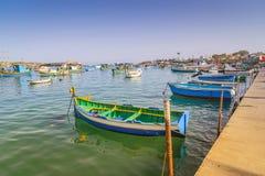 Traditional maltese fisherman boats Luzzu in Marsaxlokk bay in Malta. stock image