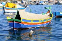 A traditional Maltese fishing boat. S & x28;or kajjik& x29; moored in the port of Marsaxlokk in Malta Stock Images