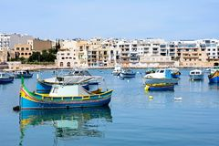 Birzebugga harbour, Malta. Traditional Maltese fishing boats in the harbour, Birzebbuga, Malta, Europe Stock Image