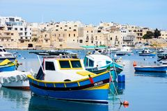 Fishing boats in Birzebugga habour, Malt. Traditional Maltese fishing boats in the harbour, Birzebbuga, Malta, Europe Royalty Free Stock Image