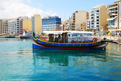The traditional Maltese Luzzu boat for tourists cruises. SLIEMA, MALTA - APRIL 22: The traditional Maltese Luzzu boat for tourists cruises on April 22, 2015 in Royalty Free Stock Photos