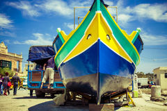 A traditional Maltese luzzu fishing vessel. Maltese fishing village Marsaxlokk royalty free stock photography