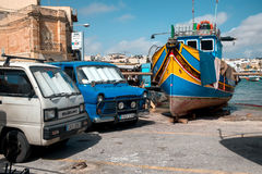 Traditional maltese painted boats at the Marsaxlokk bay. MARSAXLOKK, MALTA - SEPTEMBER 26 :The legendary and iconic Malta fishing boats in the Marsaxlokk village Stock Photos