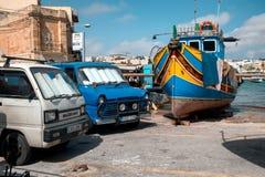 Traditional maltese painted boats at the Marsaxlokk bay Stock Photos