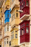 A traditional Maltese style balconies. Valletta. A traditional Maltese style different colored  balconies in Valletta. Malta Royalty Free Stock Images