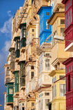 A traditional Maltese style balconies. Valletta. Royalty Free Stock Photo