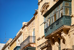 A traditional Maltese style balconies. Valletta. A traditional Maltese style balconies of Republic street building in Valletta, Malta Stock Image