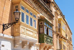 A traditional Maltese townhouses with colorful balconies in Birg. A traditional Maltese townhouses (maisonnette) with colorful balconies (gallerija) in Birgu Stock Images