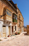 A traditional Maltese townhouses with colorful balconies in Birg Stock Photos
