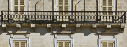 Traditional maltese windows. Building with traditional maltese windows in historical part of Valletta Stock Photography