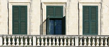 Traditional maltese windows. Building with traditional maltese windows in historical part of Valletta Stock Image