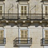 Traditional maltese windows. Building with traditional maltese windows in historical part of Valletta Royalty Free Stock Photo