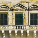 Traditional maltese windows. Building with traditional maltese windows in historical part of Valletta Stock Images