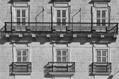 Traditional maltese windows. Building with traditional maltese windows in historical part of Valletta. Black and white picture Royalty Free Stock Images