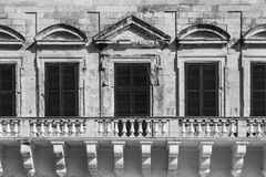 Traditional maltese windows. Building with traditional maltese windows in historical part of Valletta. Black and white picture Stock Images