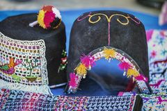 Traditional man`s hat and weavings laid out on the local sunday market of Tarabuco, Bolivia. South America Stock Image