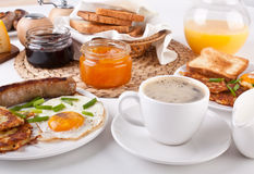 Traditional Manhattan brunch. With Sausage, Bacon, Fried Egg, Hashbrowns, Coffee and Orange Juice Royalty Free Stock Image