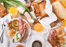 Traditional Manhattan brunch. With Sausage, Bacon, Fried Egg, Hashbrowns, Coffee and Orange Juice Royalty Free Stock Images