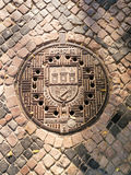 Traditional manhole cover for street hatchway in Prague Royalty Free Stock Photography