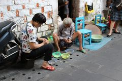 Traditional manual work on the street Asian market Royalty Free Stock Photo