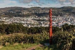 Traditional Maori totem above Wellington panorama Stock Images