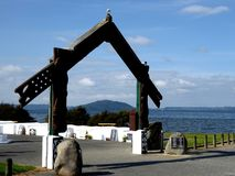 Traditional Maori Wooden carved gate in front of lake rotorua new zealand Royalty Free Stock Photos