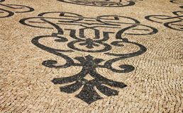 Traditional marble mosaic on street in Lisbon Royalty Free Stock Photos