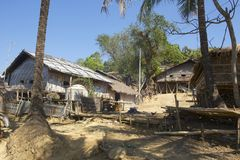Traditional Marma hill tribe buildings exterior, Bandarban, Bangladesh. BANDARBAN, BANGLADESH - FEBRUARY 20, 2014: Traditional Marma hill tribe buildings stock image