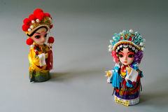 Traditional married Chinese dolls isolate on gray background - focus on bride. Traditional married Chinese dolls isolate on gray background Stock Photo