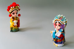 Traditional married Chinese dolls isolate on gray background - focus on groom Royalty Free Stock Image