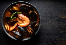 Traditional Marseille Bouillabaisse fish soup with prawns, mussels tomato, lobster and squid. Flat lay. Stock Images