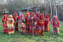 Traditional masquerade group. From north Portugal, in a long exposure, one of those still and the others moving royalty free stock photo