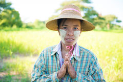 Traditional mature Asian female farmer greeting Royalty Free Stock Photo