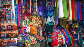 Traditional Mayan Clothing and Rugs at market in Panajachel Stock Photos