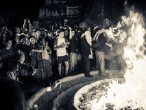 Traditional Mayan fire ritual - Tikal, Guatemala. Scenes from the 2012 Mayan new year celebrations at Tikal in Guatemala.  Onlookers take part in this Royalty Free Stock Photo